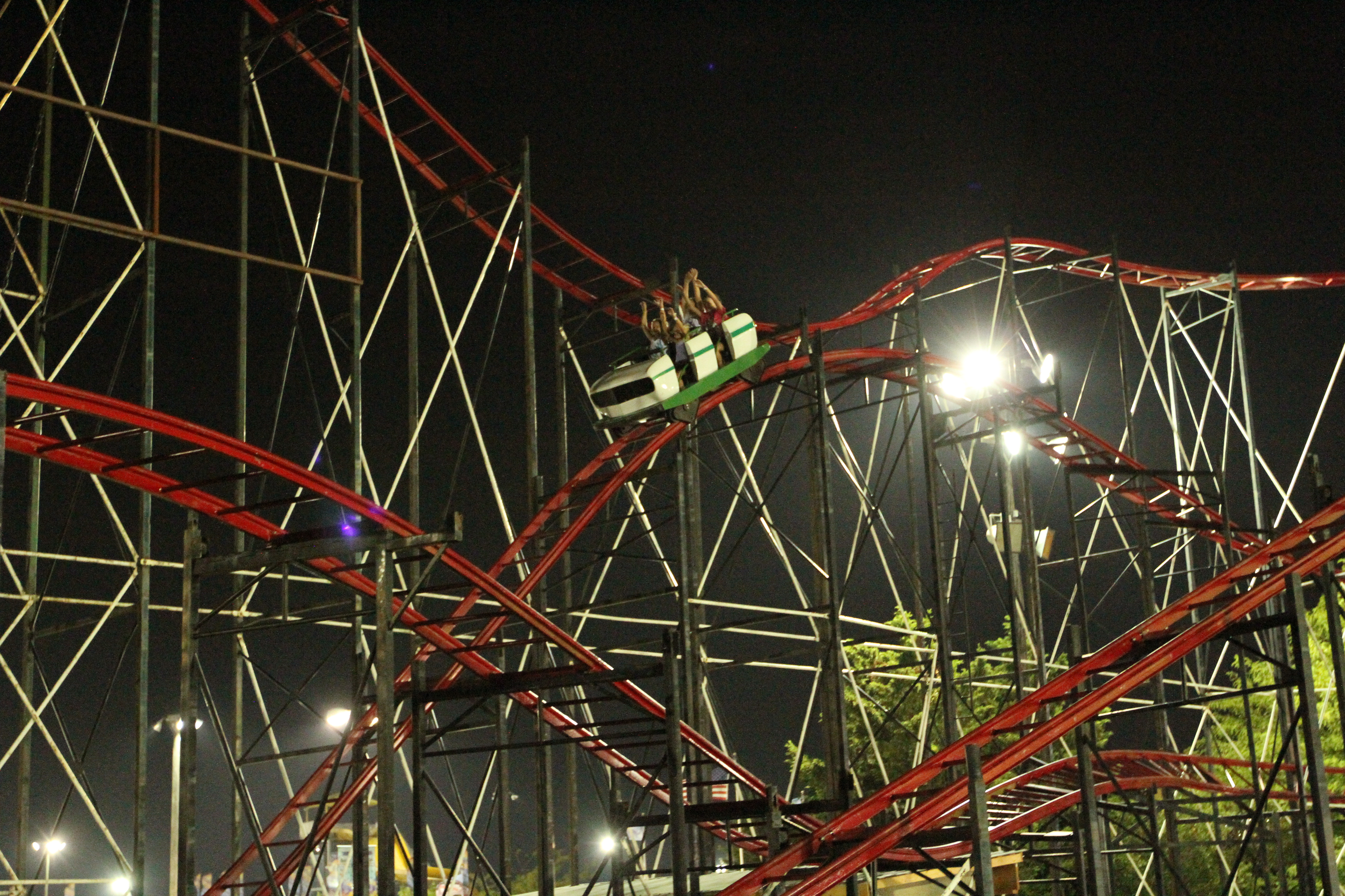 a red roller coaster at night