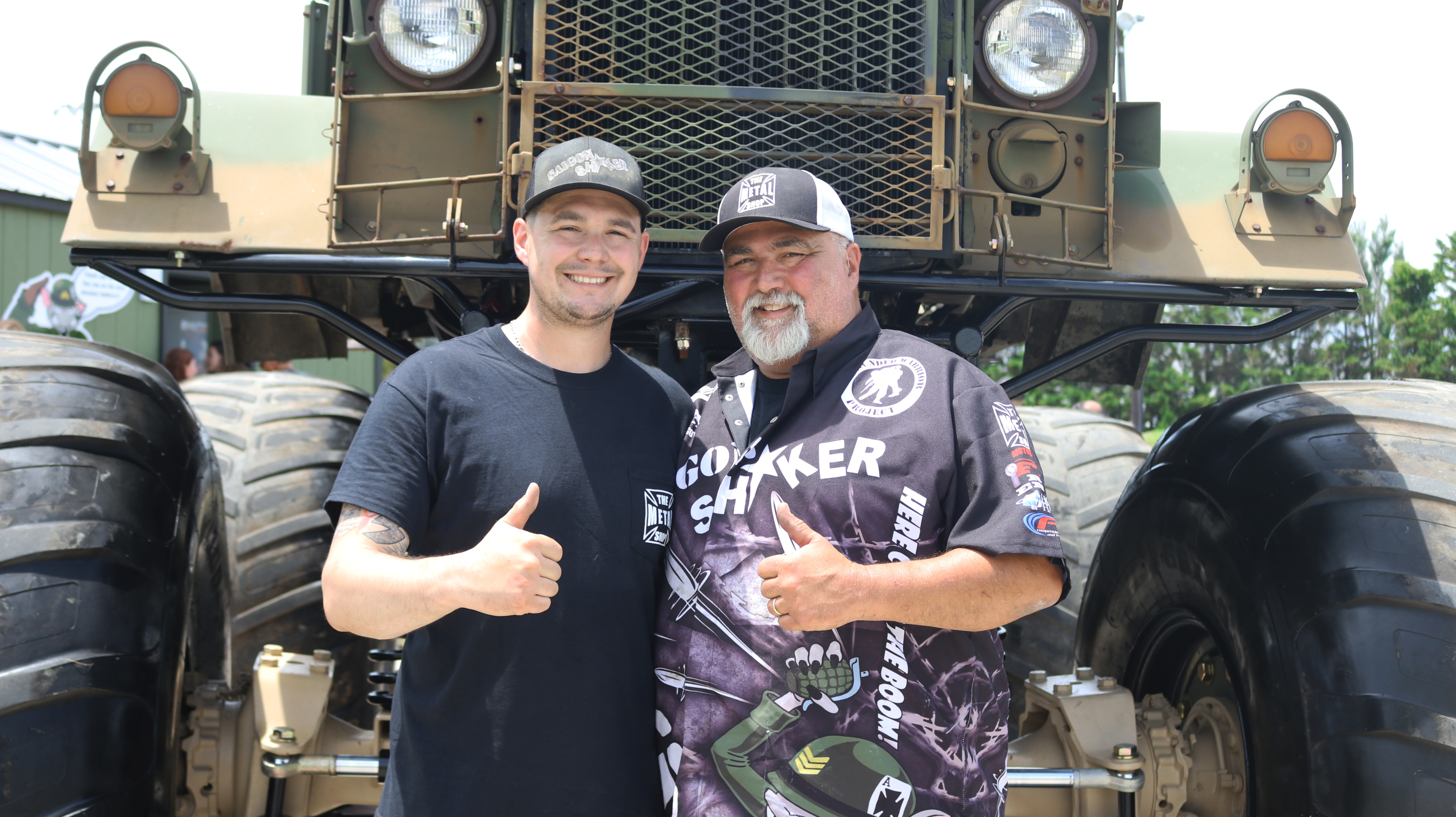 Father and Son pictured in front of the monster truck